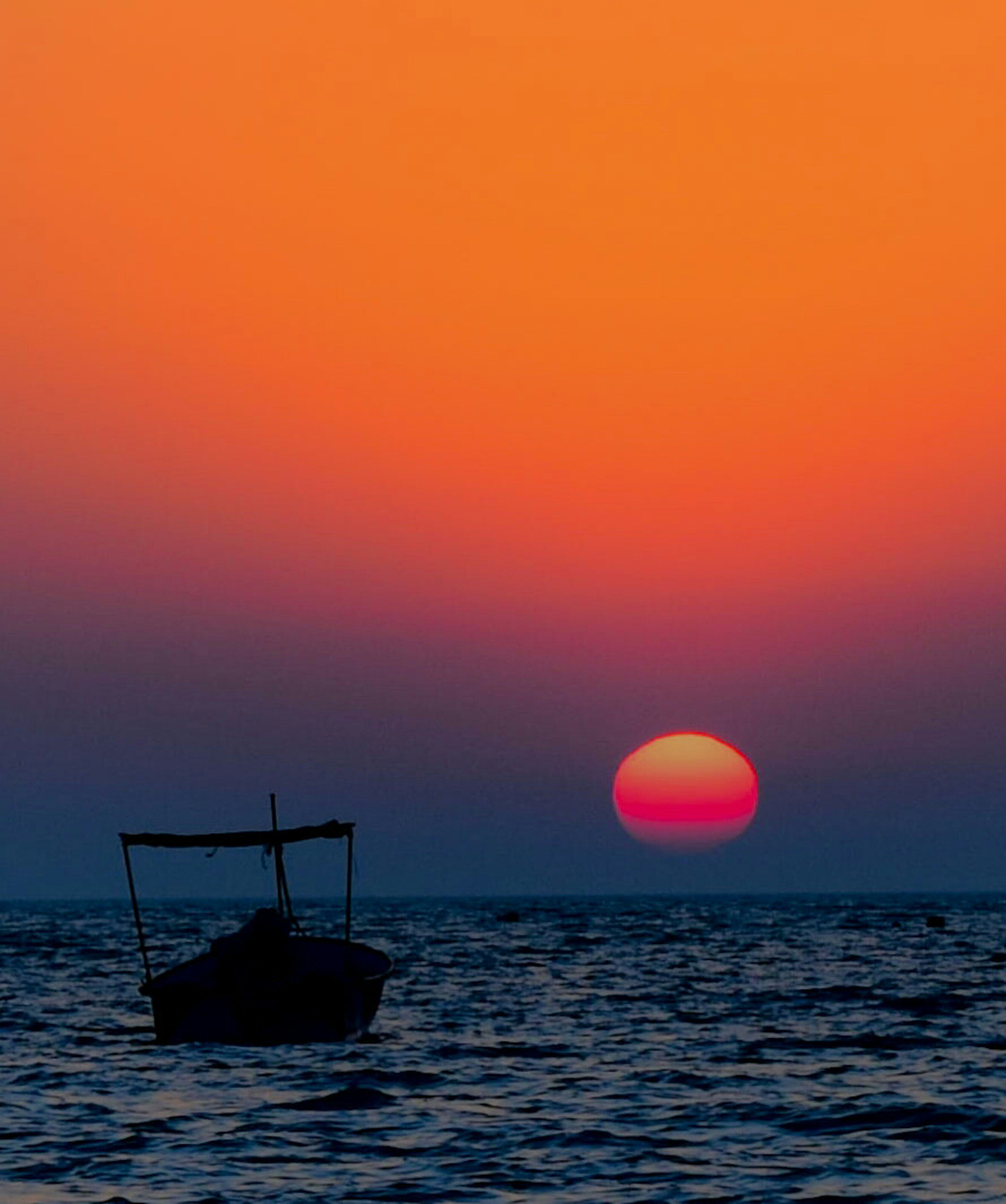 sea, horizon over water, sunset, water, sun, scenics, tranquil scene, boat, nautical vessel, waterfront, orange color, tranquility, transportation, beauty in nature, copy space, idyllic, rippled, seascape, calm, silhouette, mode of transport, ocean, nature, majestic, sky, moody sky, non-urban scene, dramatic sky, outdoors, atmospheric mood, atmosphere, colorful, journey, vibrant color, romantic sky