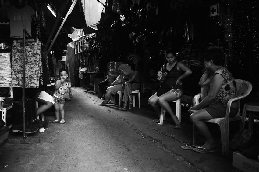 Snaps taken in the streets of Quiapo. Black And White Building Exterior Chair Full Length Large Group Of People Lifestyles Manila Outdoors Philippines Quiapo Street Photography Young Adult First Eyeem Photo