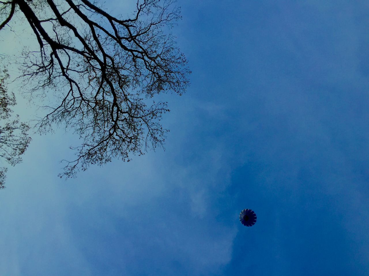 Directly Below Shot Of Hot Air Balloon Against Blue Sky
