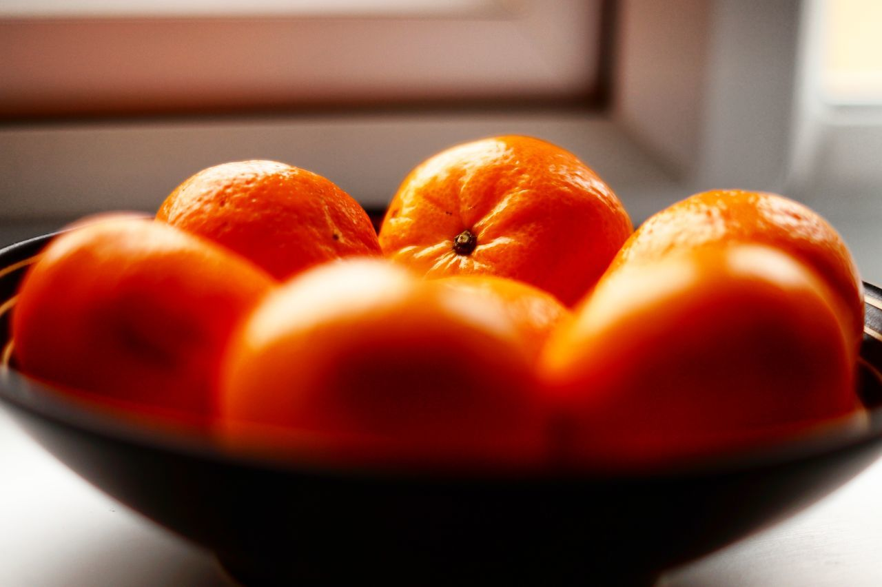 Close-Up Of Oranges In Bowl On Table