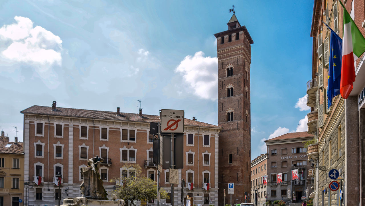 Architecture Asti Asti Italy Building Exterior Built Structure City Clock Tower Cloud - Sky Day Flag Flags History Italy Low Angle View No People Outdoors Place Of Worship Religion Sky Spirituality Travel Destinations Tree