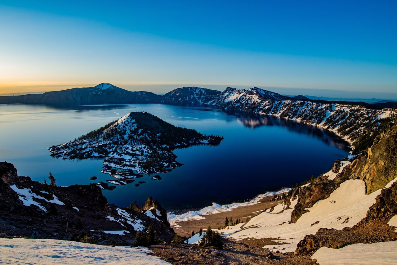 Crater Lake Mountain Beauty In Nature Nature Scenics Blue Tranquil Scene Tranquility Snow Cold Temperature Water Mountain Range Landscape Winter Lake No People Outdoors Sky Physical Geography Day Sunrise_Collection Volcanic Landscape Volcano Crater Lake National Park The Great Outdoors - 2017 EyeEm Awards The Great Outdoors - 2017 EyeEm Awards