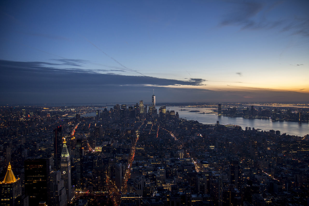 cityscape, city, architecture, building exterior, skyscraper, illuminated, built structure, crowded, sunset, sky, travel destinations, outdoors, modern
