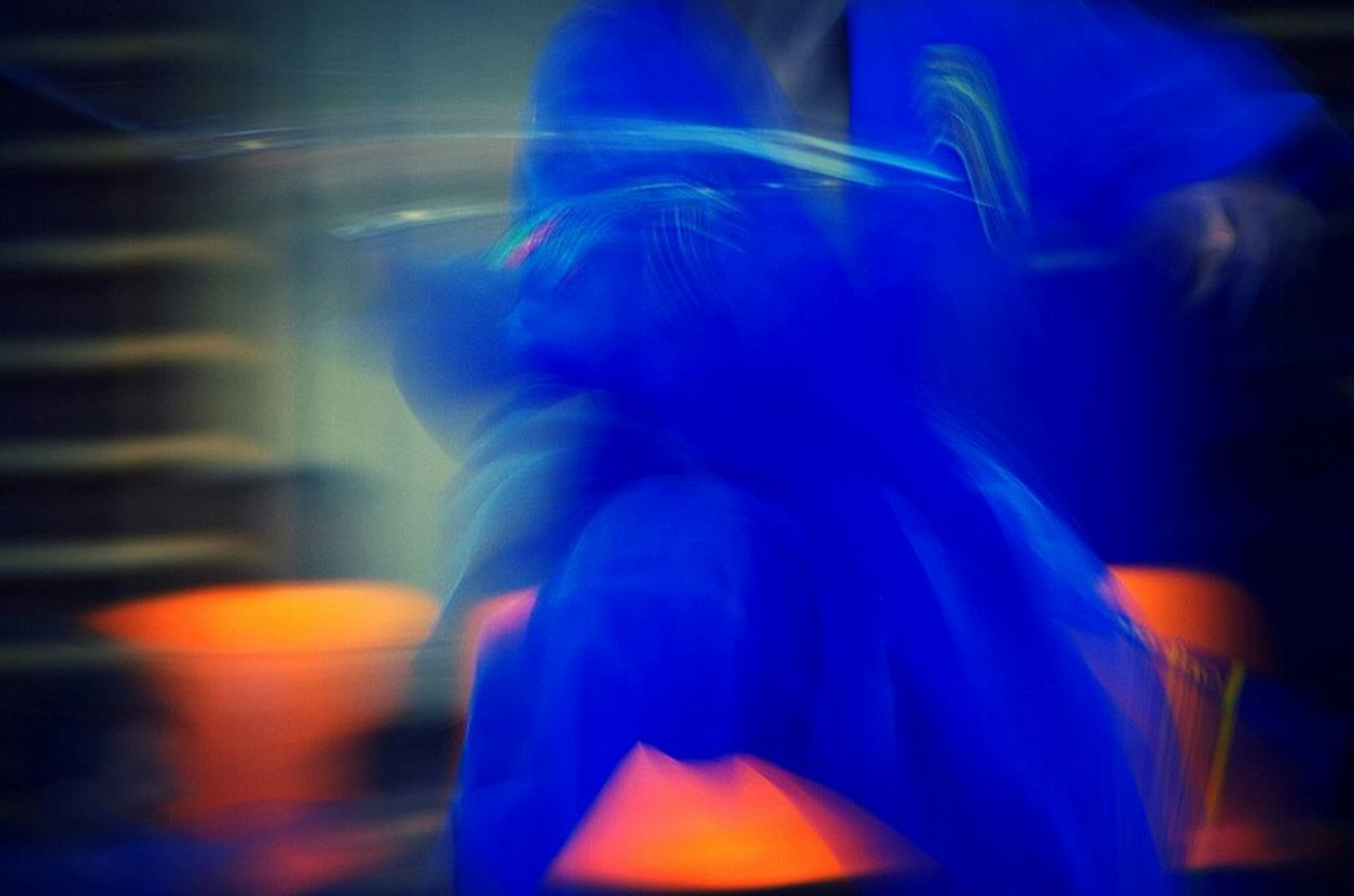 motion, blurred motion, one person, blue, real people, night, women, illuminated, indoors, human body part, one woman only, close-up, one young woman only, adult, young adult, adults only, people