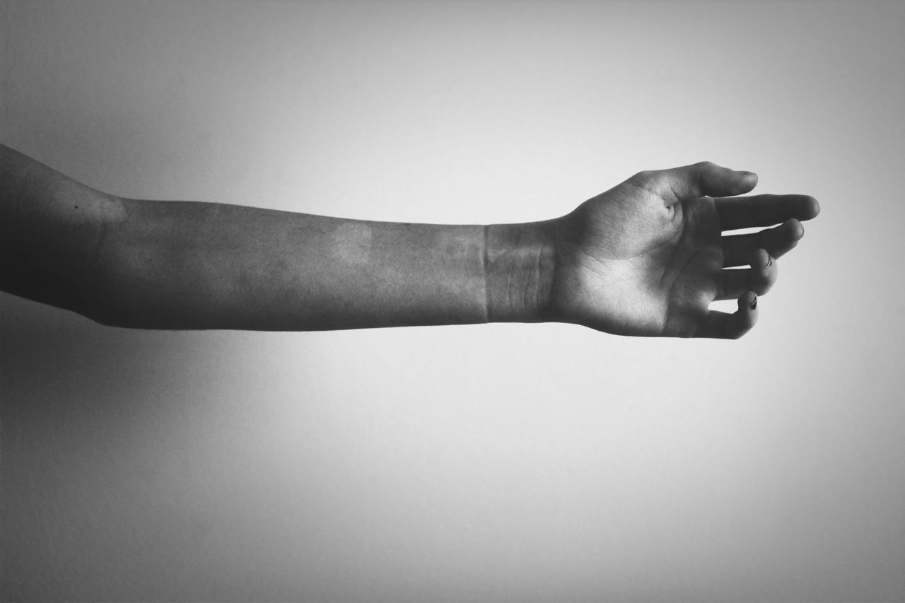 human body part, human hand, one person, studio shot, white background, real people, low section, human leg, men, lifestyles, close-up, day