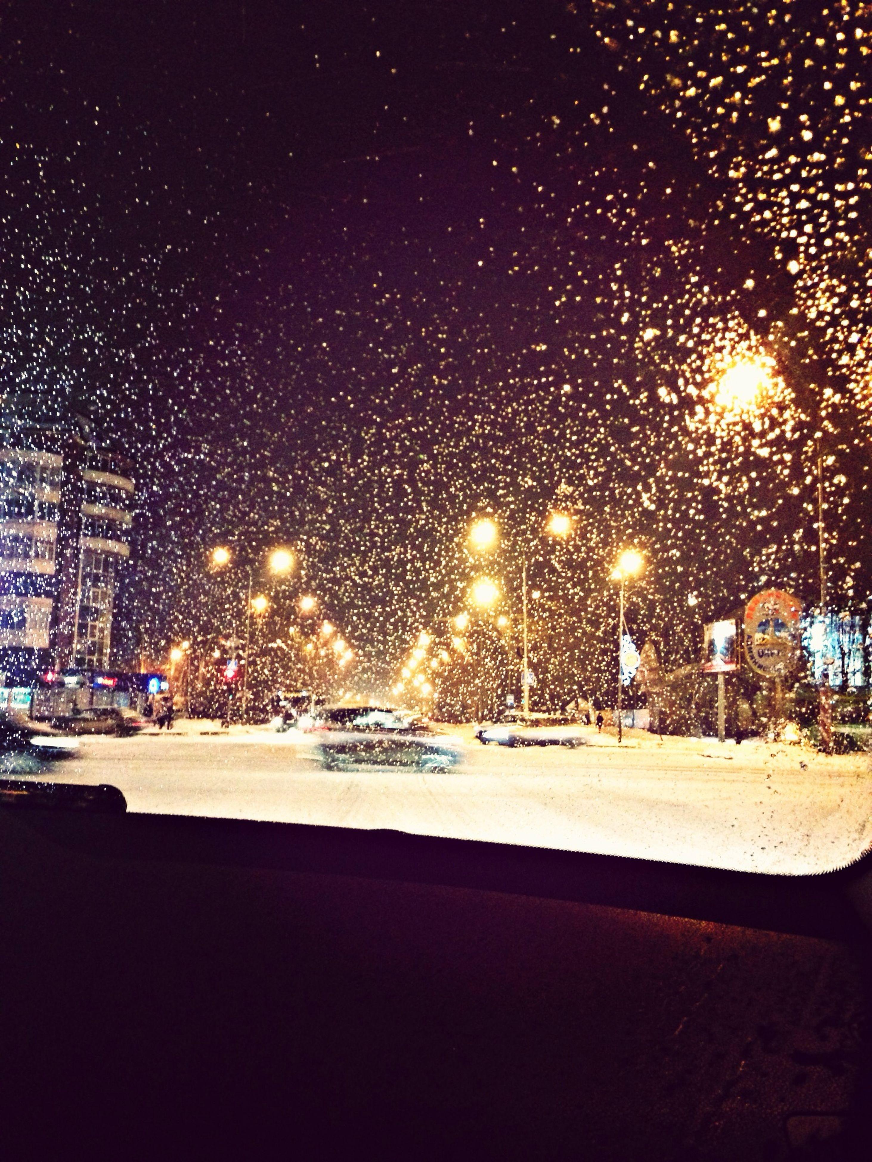 car, transportation, night, land vehicle, illuminated, season, mode of transport, wet, street, city, window, glass - material, rain, road, snow, weather, street light, transparent, building exterior, winter
