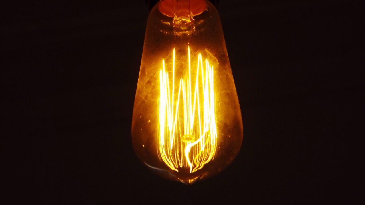 Light in a lightful day. Electricity  Lighting Equipment Illuminated Light Bulb Glowing Studio Shot Filament Close-up Electric Bulb Technology No People Fuel And Power Generation Yellow Power Supply Black Background Indoors  Light