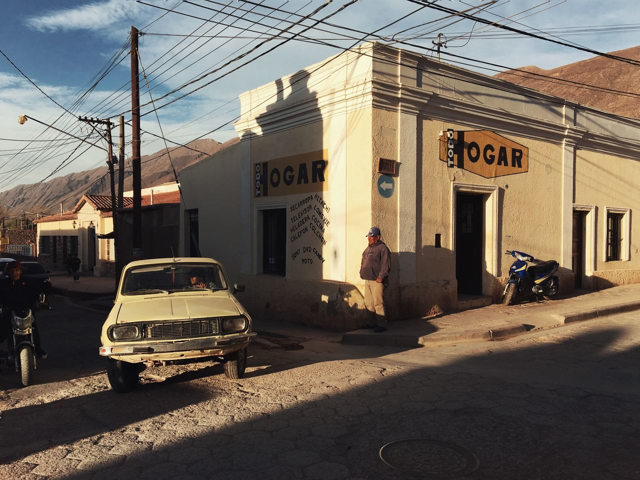 Architecture Argentina Building Exterior Built Structure Car Day Hogar Mode Of Transport Old Car Outdoors Road Road Trip Shadow Snap A Stranger Street Sunset The Drive Tilcara Transportation ShotoniPhone6s Mobilephotography IPhoneography