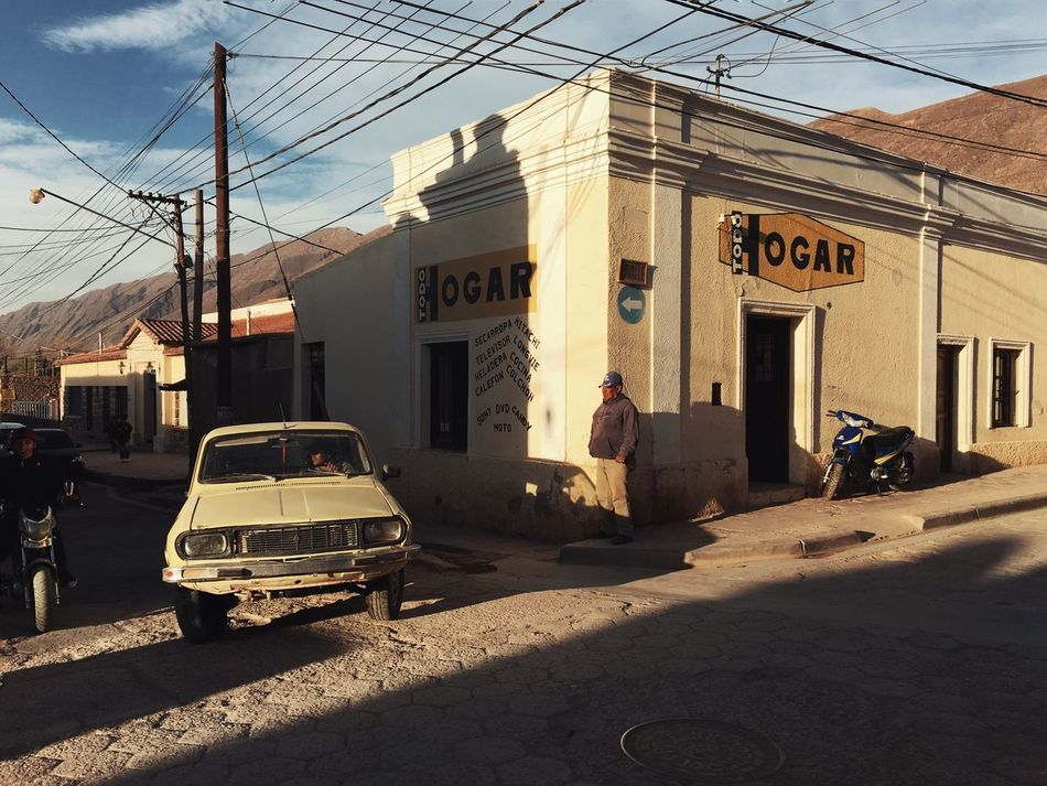 Architecture Argentina Building Exterior Built Structure Car Day Hogar Mode Of Transport Old Car Outdoors Road Road Trip Shadow Snap a Stranger Street Sunset The Drive Tilcara Transportation ShotoniPhone6s Mobilephotography IPhoneography Finding New Frontiers Miles Away