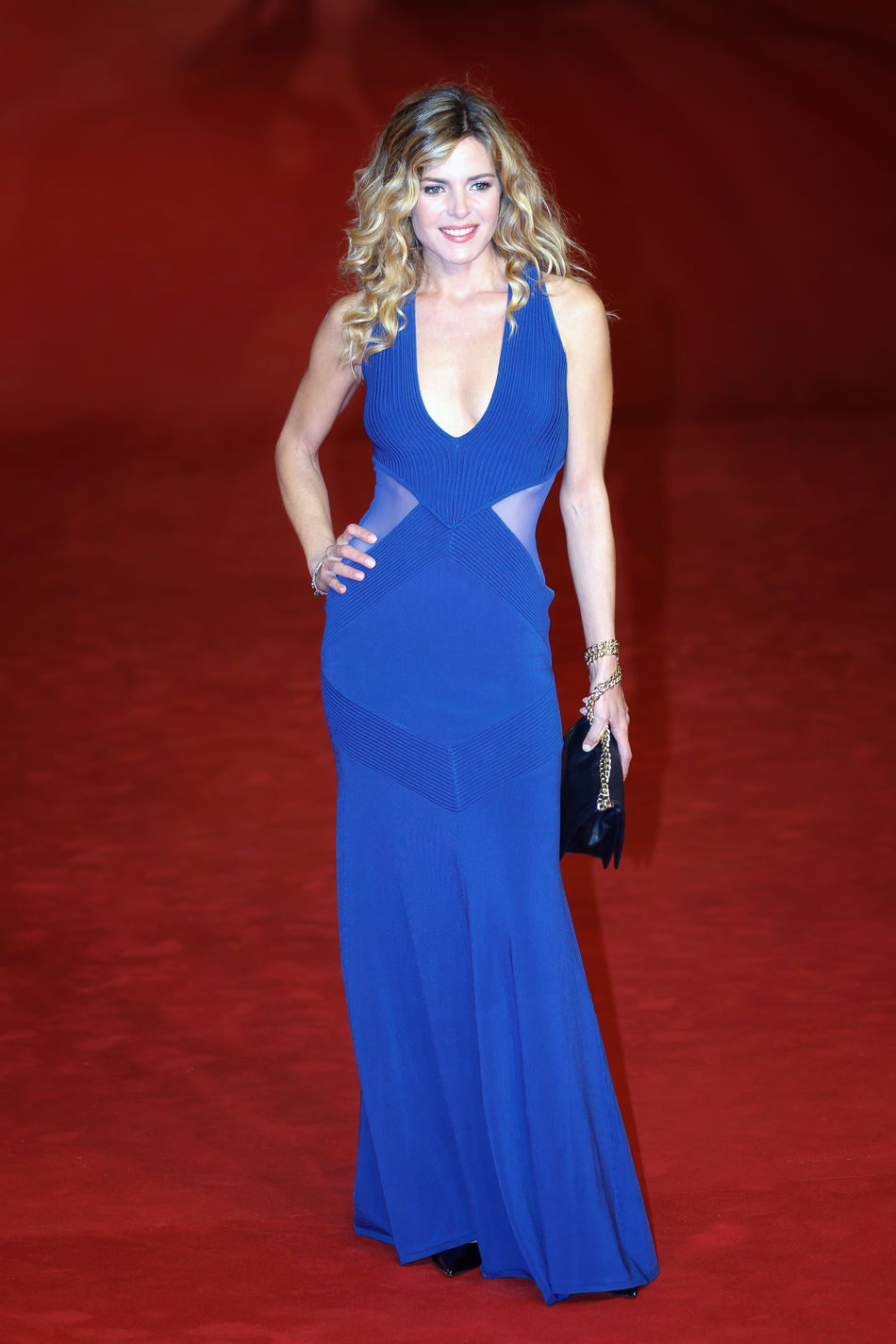 """Rome, Italy - October 13, 2016: Elisabetta Pellini walks a red carpet for """"Moonlight"""". Actress Adults Only Blonde Girl Blonde Hair Cinema Elisabetta Pellini Ff11 One Person One Woman Only One Young Woman Only Only Women Pellini Portrait Red Background Red Carpet Event Rome Film Fest"""