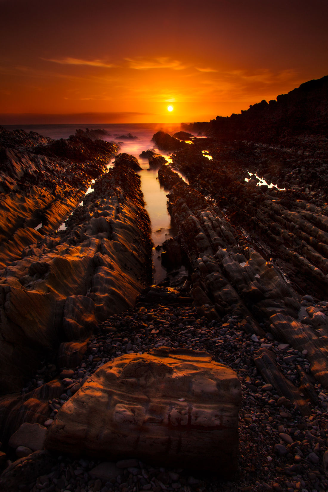 A Moment of Gold. There are days when the sun burns through the ocean's mist and turns the sky gold. Dramatic Coast Dramatic Light Landscape_photography Lens Flare Majestic No People Ocean Orange Sky Outdoors Pacific Ocean Patterns Rock Formation Scenic Sun Sunbeam Sunset