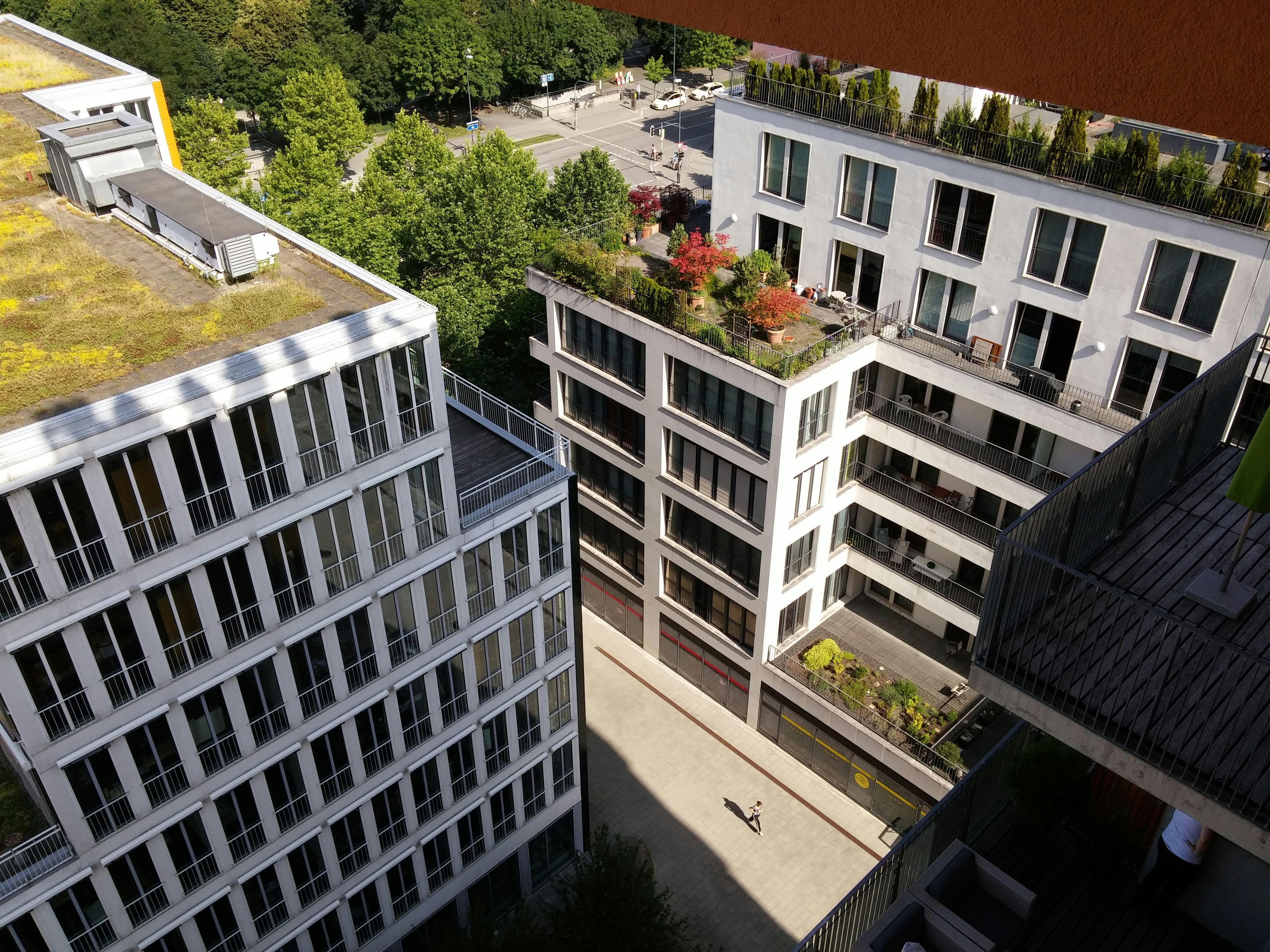 building exterior, architecture, built structure, residential building, residential structure, city, building, window, house, high angle view, apartment, tree, residential district, day, outdoors, no people, balcony, sunlight, modern, roof