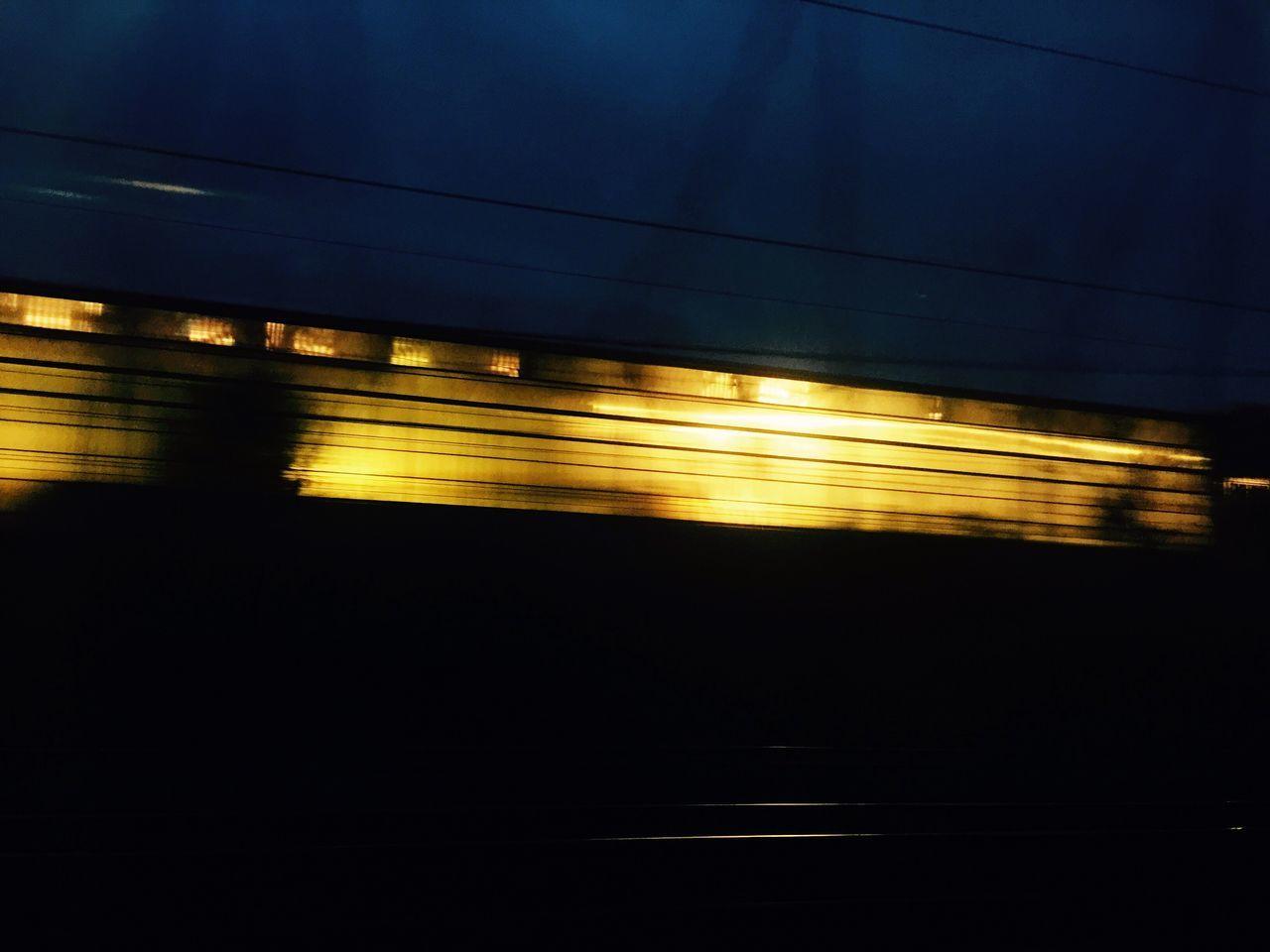 transportation, blurred motion, rail transportation, night, illuminated, public transportation, speed, train - vehicle, mode of transport, motion, no people, railroad track, outdoors