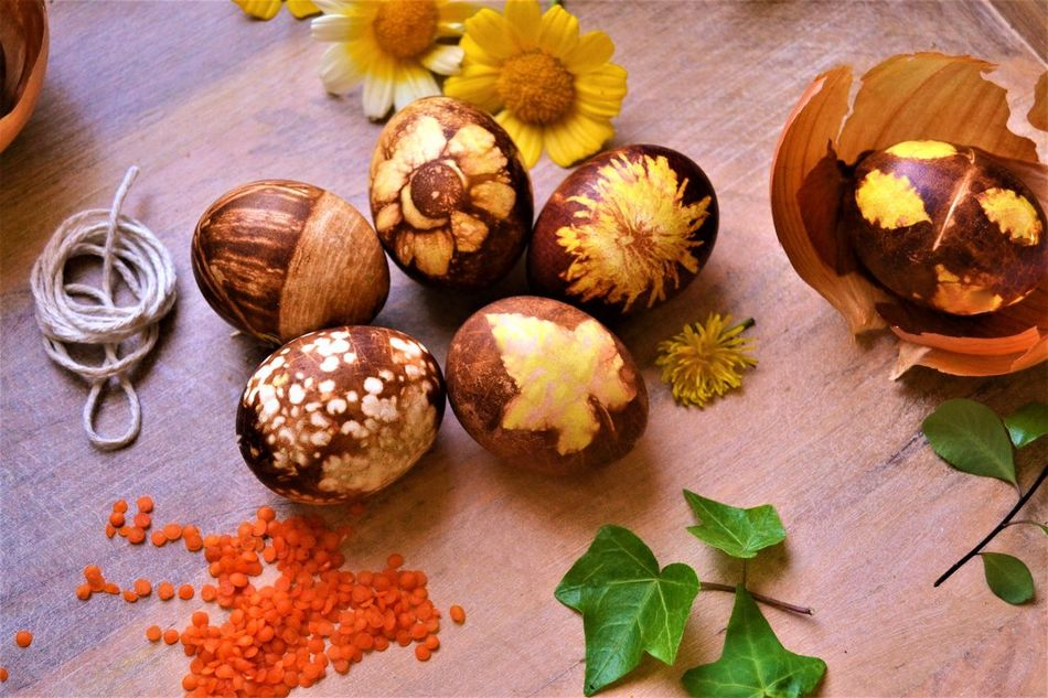 Layout of naturally colored eggs in onion skin water using elements from nature to make different shapes on egg. No artificial colors. Fun project with kids on Easter. Egg art. Amazing experience. Experiments Beautiful Close-up Day Directly Above DIY Diy Easter Easter Egg Arts Experimental Flower Flower Head Food Food And Drink Freshness Fun Project High Angle View Indoors  Leaf Natural Pattern Nature Colors No People Onion Ready-to-eat Shape Table