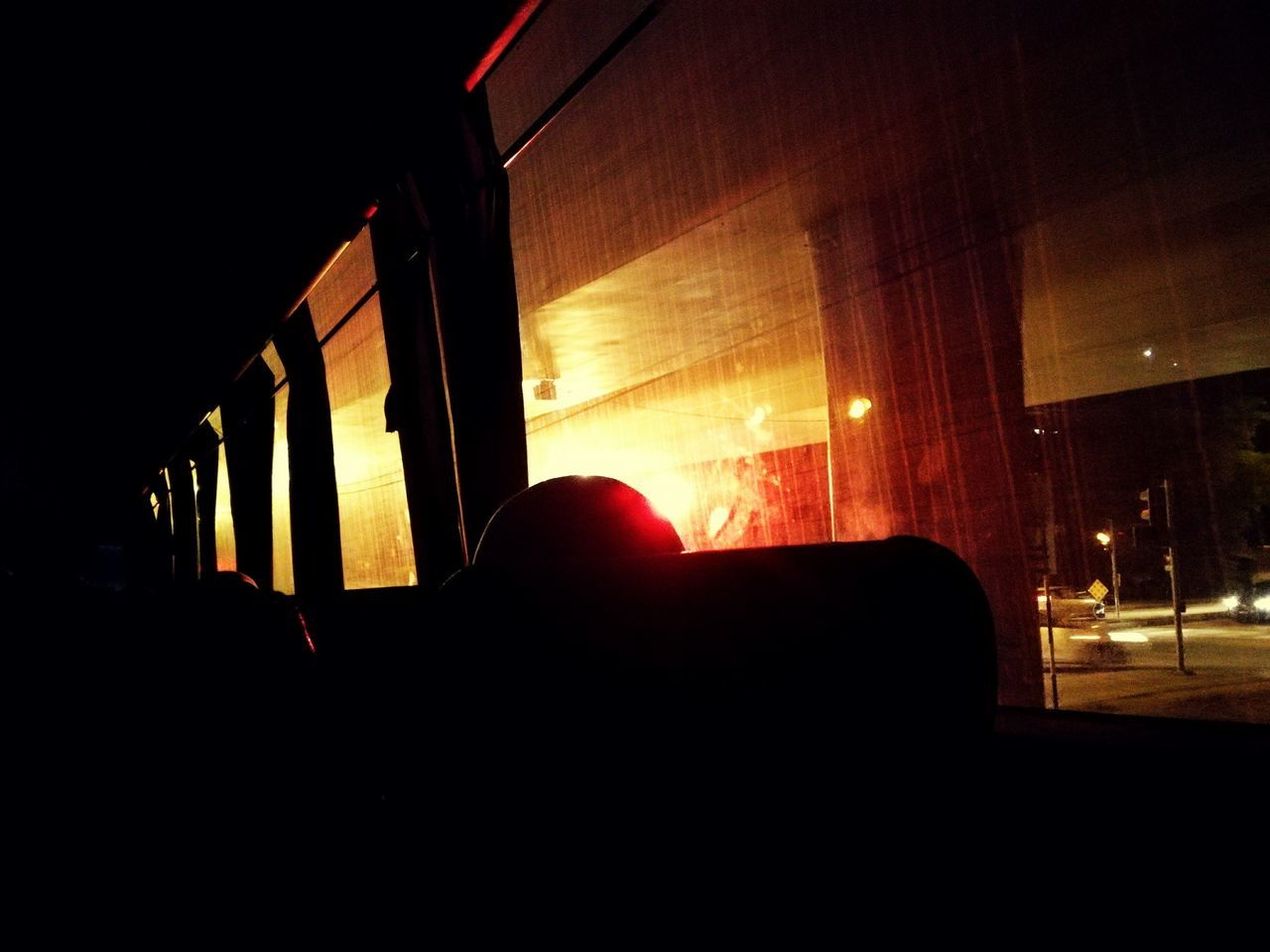 Night Illuminated Indoors  Human Body Part One Person People Red Bus Black Traffic Car Outdoors City Life Sky Sleep Awake Destination Travel HEAD