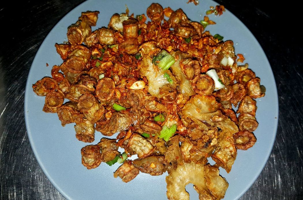 Deep fried intestinal of pork with garlics and peppers. Food Food And Drink High Angle View No People Healthy Eating Ready-to-eat Close-up Indoors  Freshness Night Garlic Pork Intestines Crispy Golden