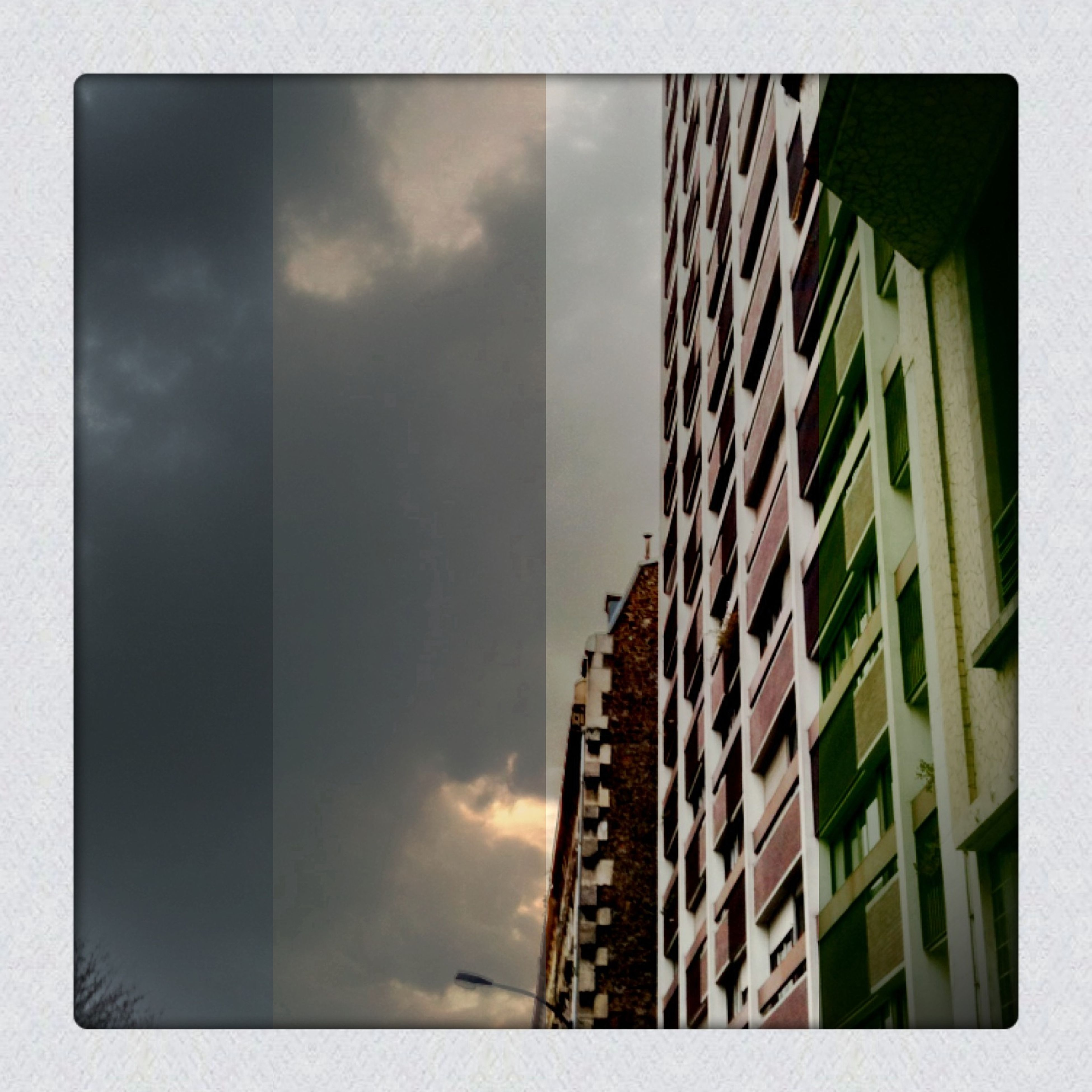 architecture, building exterior, built structure, transfer print, low angle view, sky, auto post production filter, building, city, cloud - sky, residential structure, residential building, window, cloud, day, outdoors, no people, cloudy, modern, overcast