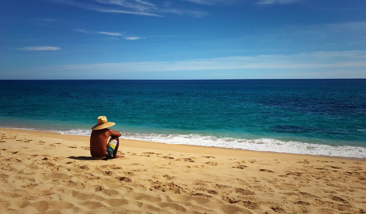 Beach Sea Sand Water Vacations Relaxation Relaxing Moments Shore Horizon Over Water Sky Ocean Ocean View Full Length Rear View Nature Lifestyles One Person Scenics Solitude Alone Thinking Lifestyle Destination Travel