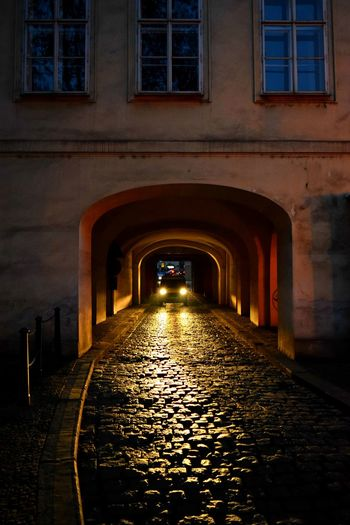 Approaching Architecture Built Structure Car Cars Coming Through Darkness And Light Light And Shadow Night View Nightphotography Nightshot No People Outdoors Photography Street Street Photography Streetphotography The Way Forward Under Building