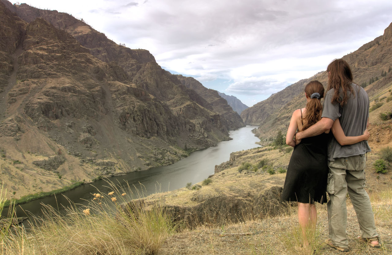 Rear View Of Couple Looking At Valley In Hells Canyon