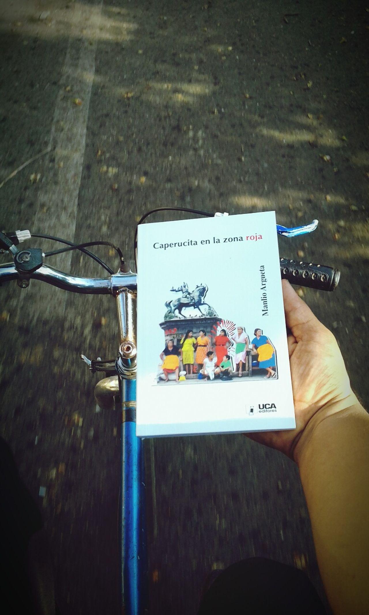 Outdoors One Person Human Body Part Close-up Human Hand Adult Bike Biker Bike Ride Ontheroad Onthestreet Ontheway Read Reading Reader Book