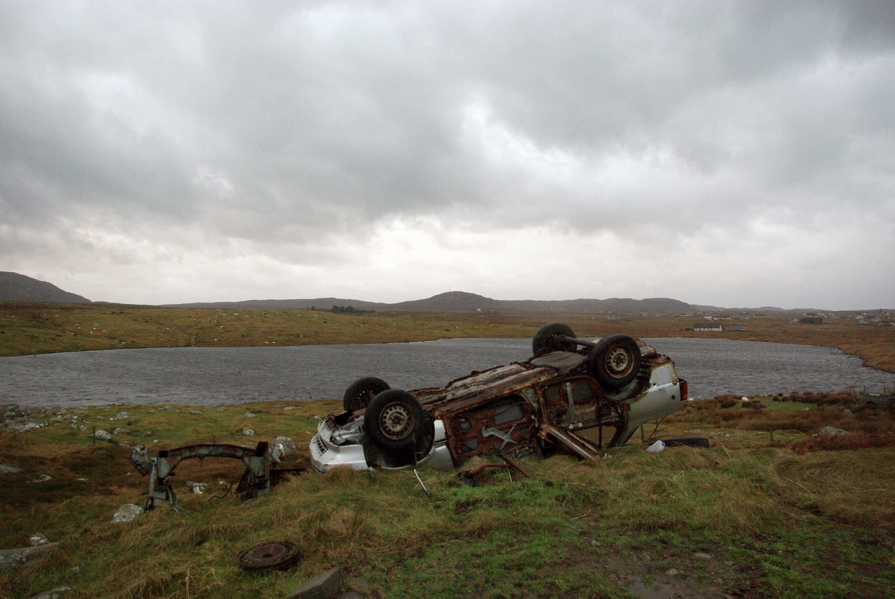 Scrap car Rural Scene Fly Tipping. Illegal Dumping Waste Management Outdoors Abandoned No People Day Sky Transportation Junk Cars Scenics Water Mountain Nature Isle Of Lewis Outer Hebrides