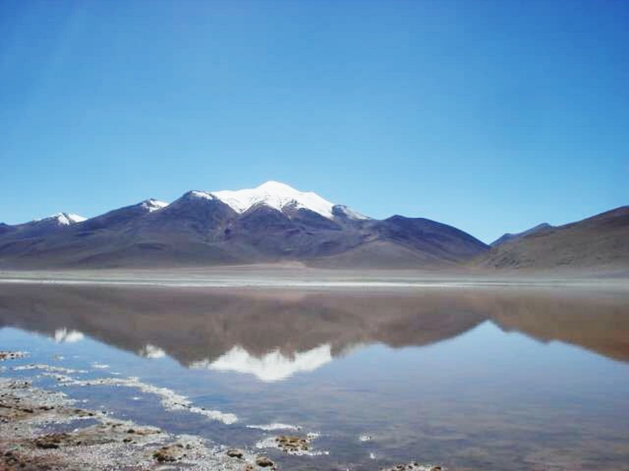 mountain, reflection, lake, scenics, nature, outdoors, landscape, blue, snow, day, mountain range, purity, beauty in nature, no people, clear sky, tranquility, the natural world, sky, water, salt flat, snowcapped mountain, salt - mineral