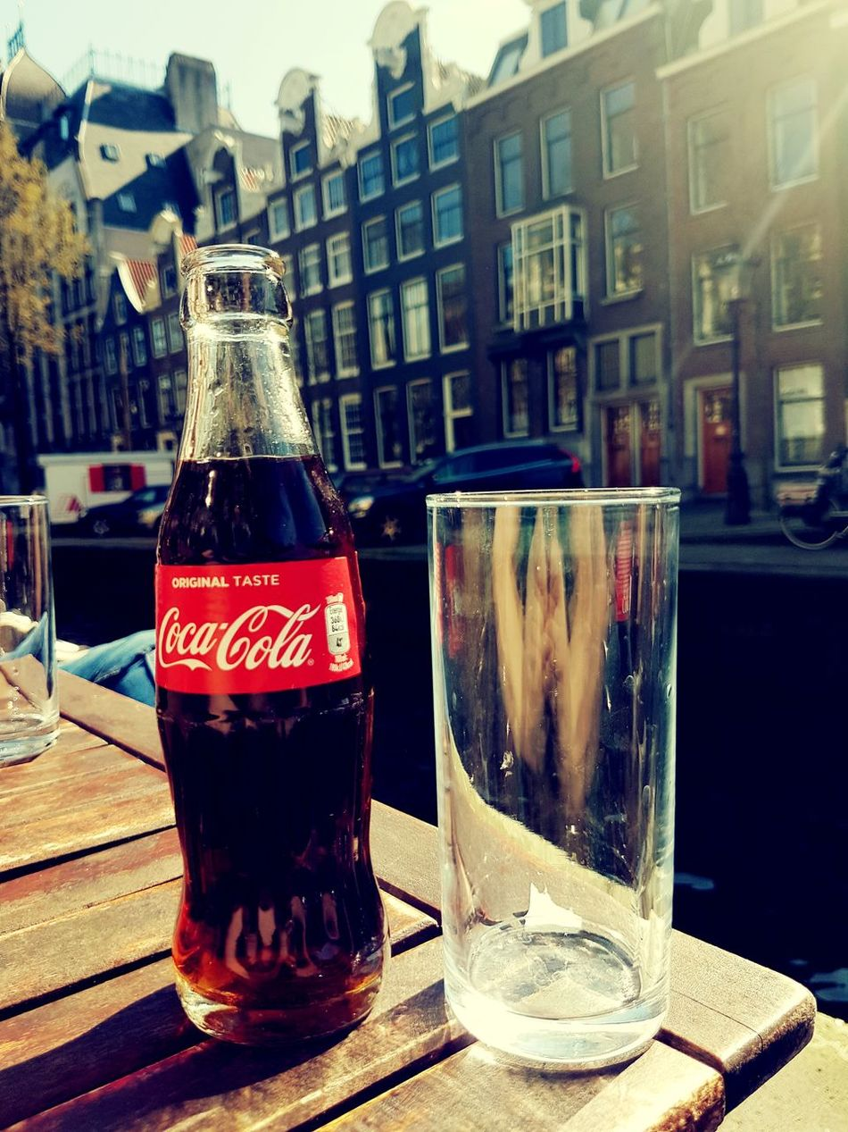Amsterdam, 27th of March 2017 City Drink Food And Drink Architecture No People Close-up Water Outdoors Canal Buildings Coca Cola Coke Coca-cola Sun Amsterdam Jordaan