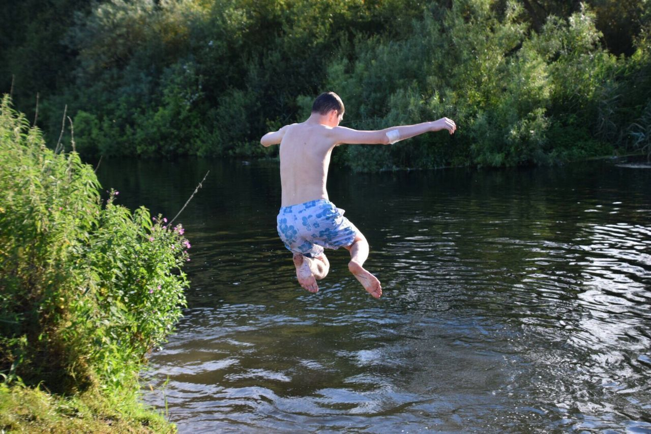 Full Length Barefoot One Person Water Vitality Outdoors River Jumping Wiltshire Countryside Riverside Photography Wiltshire UK Childhood River Swimming Hot Days Family Time Mid-air Freedom Shirtless People Fun Only Men Nature Jumping Balance Adult Enjoyment