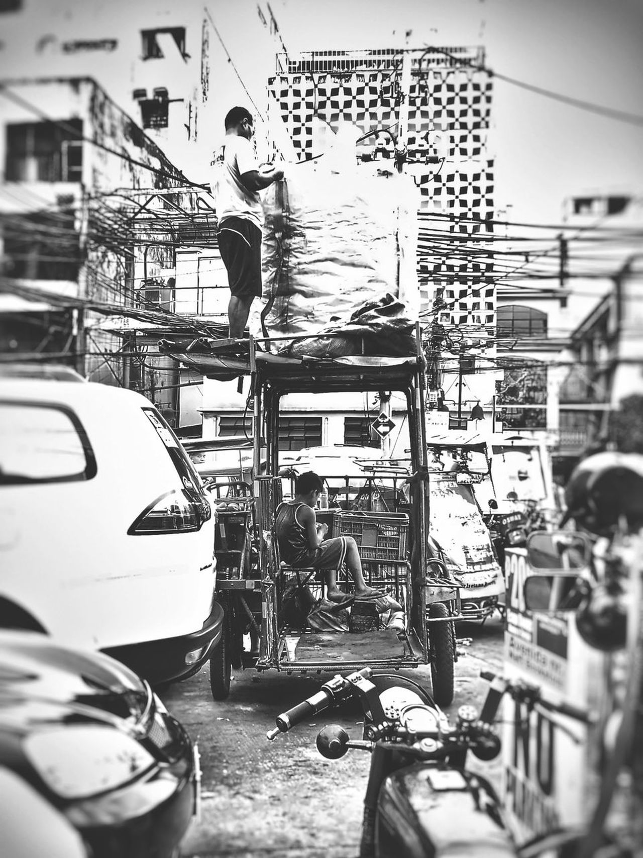 Father and son. Men Occupation Real People EyeEmNewHere Street Life Street Streetphotography Black And White Black&white Blackandwhite Photography Blackandwhite Streetphoto_bw Still Life Street Photography First Eyeem Photo Working People EyeEm Best Shots EyeEmBestPics Eyeem Philippines EyeEm Best Shots - Black + White