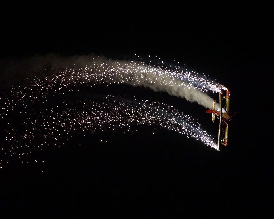Nighttime Airshow Abstract Airplane Airshow Black Background Close-up Dark Fireworks Glowing Illuminated Light Night Nighttime Airshow No People Smoke - Physical Structure