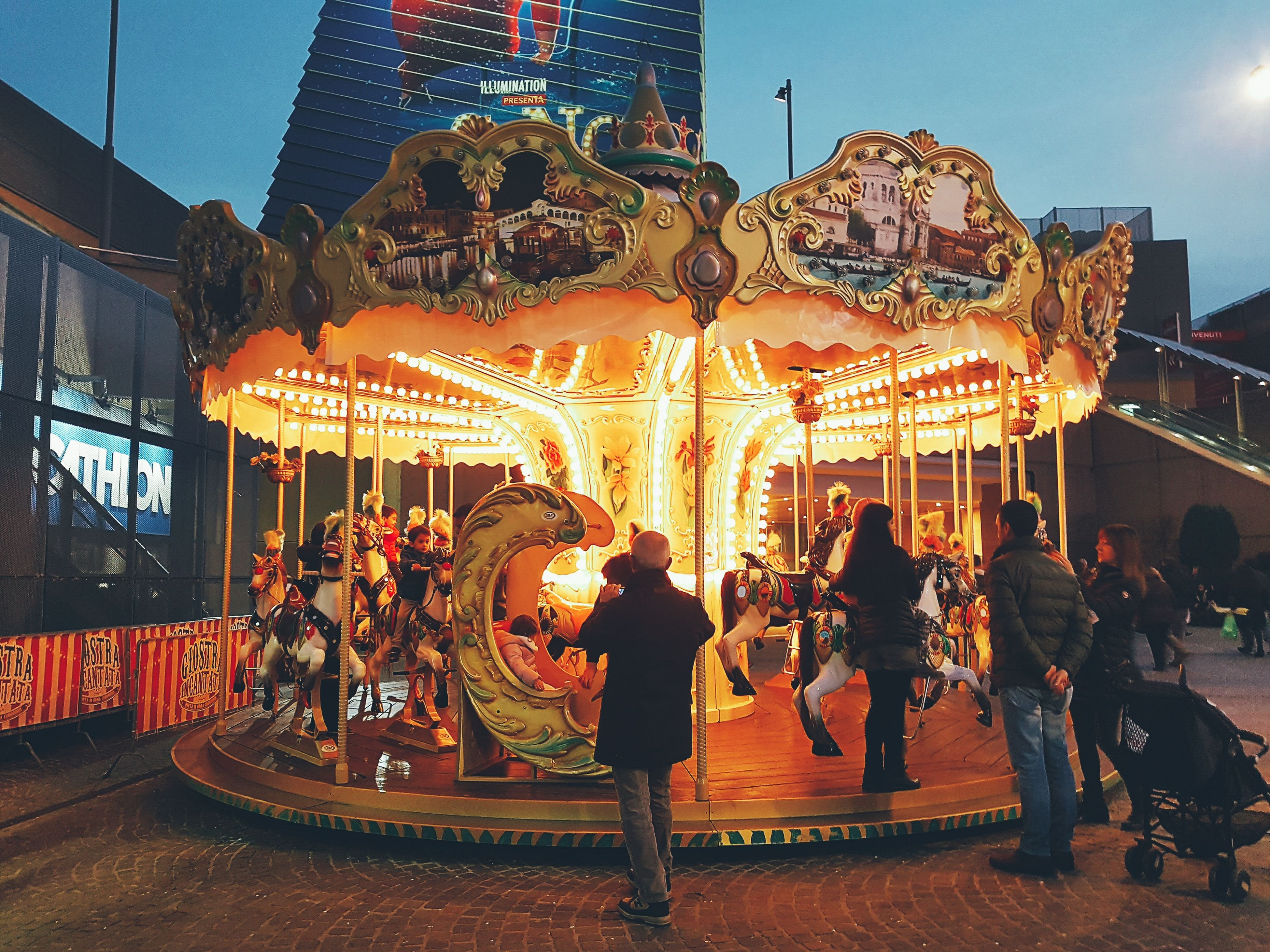 illuminated, lighting equipment, amusement park, night, arts culture and entertainment, carousel, amusement park ride, sky, outdoors, people
