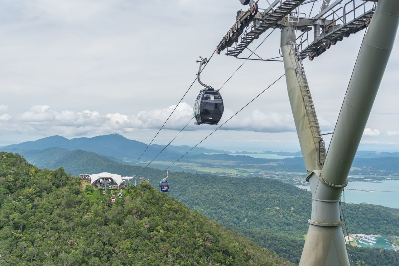 Gondola in Langkawi. Adult Adults Only Beauty In Nature Cloud - Sky Day Gondola Gondola Lift Hanging Holiday Landscape Langkawi Malaysia Mid Air Mountain Mountain Range Nature Outdoors Overhead Cable Car People Rural Scene Scenics Ski Lift Sky Tranquility Transportation