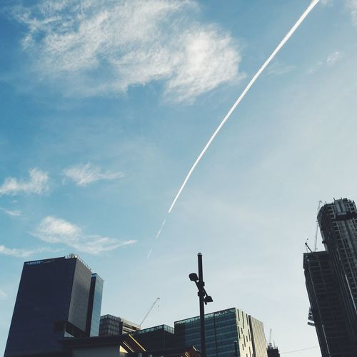Adapted To The City Vapor Trail Low Angle View No People Beauty In Nature Sky Outdoors Contrail Day Nature