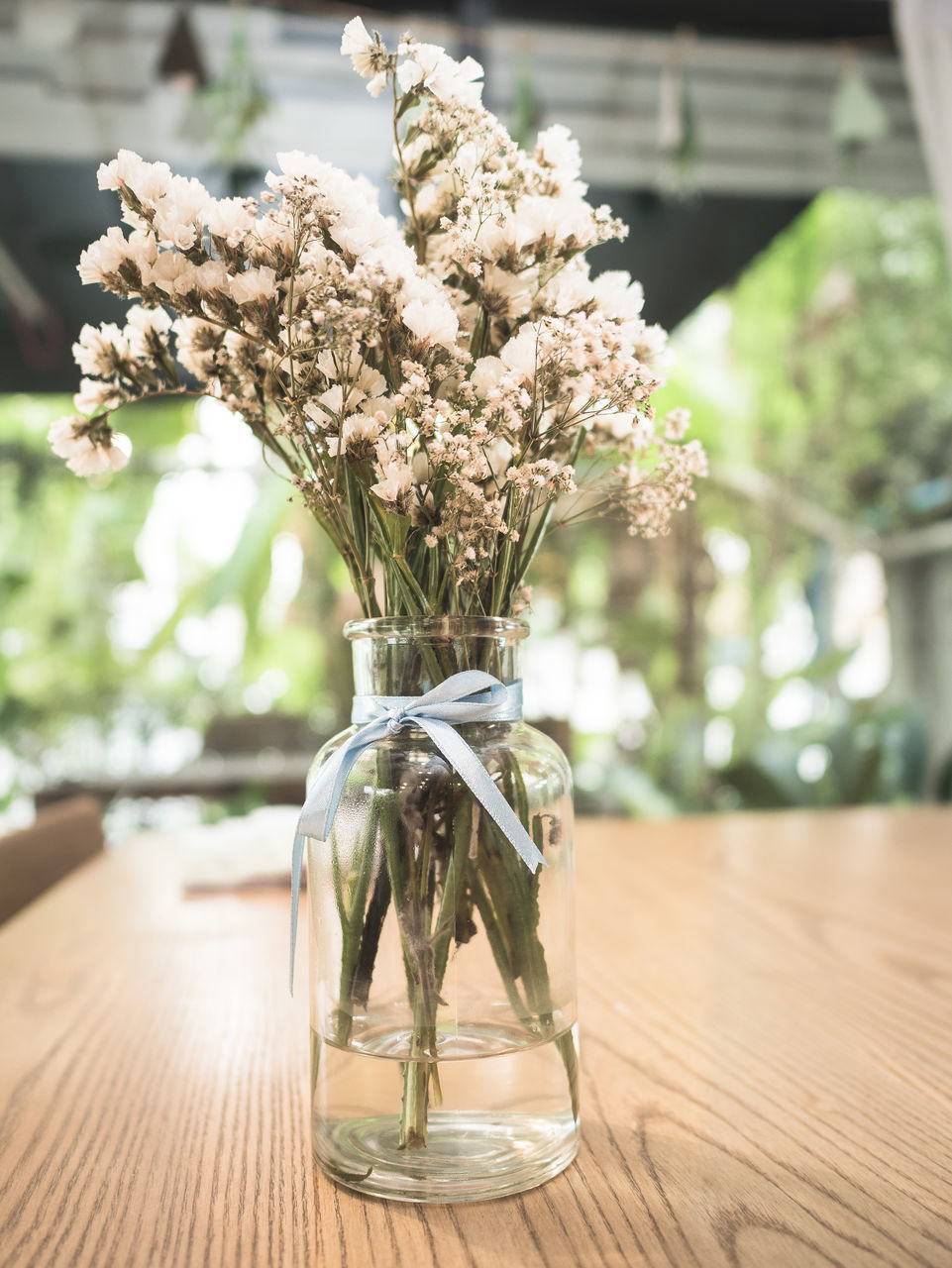 table, wood - material, focus on foreground, no people, indoors, vase, day, close-up, flower, nature, fragility, freshness, tree