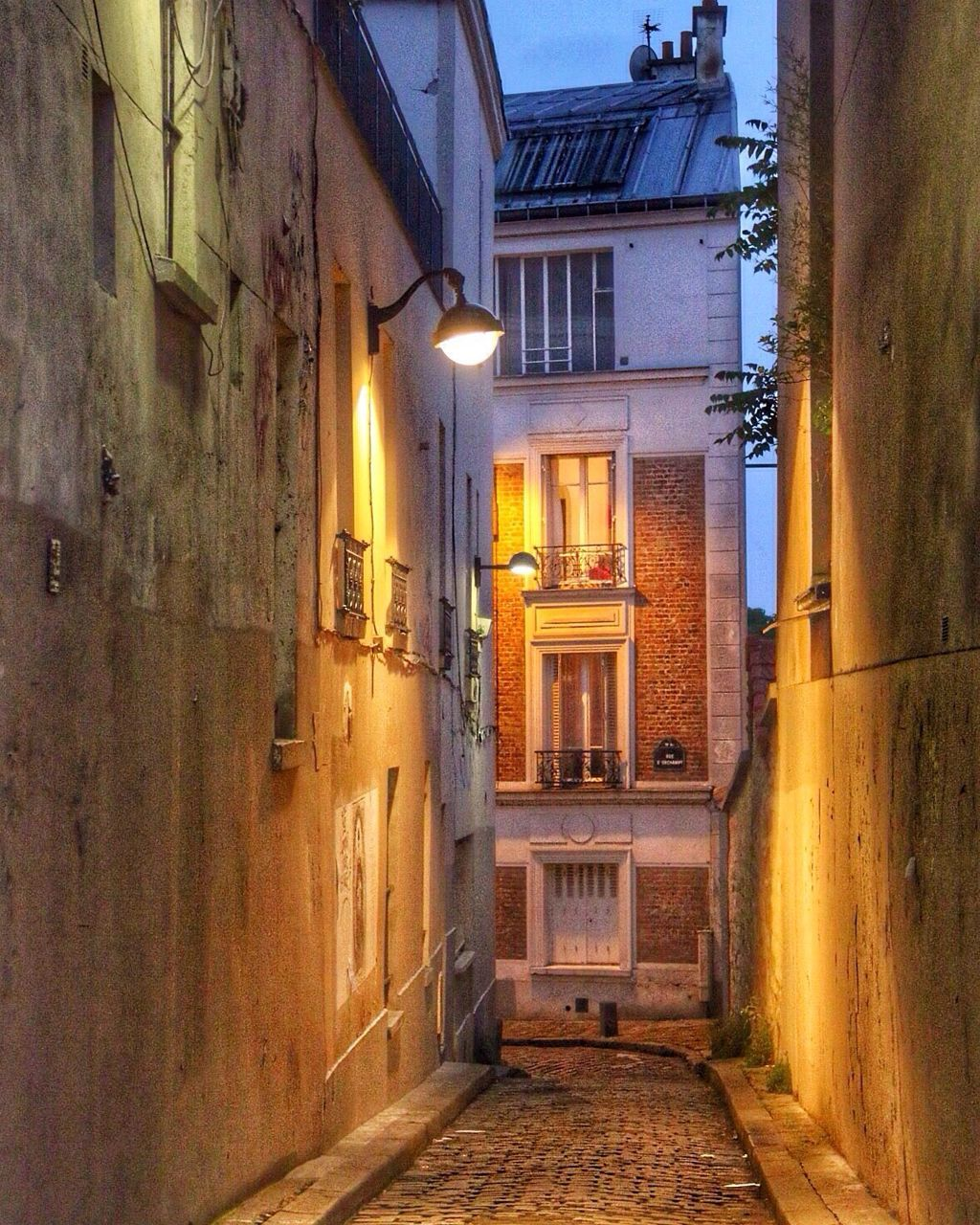 architecture, building exterior, built structure, residential building, the way forward, house, alley, no people, illuminated, window, outdoors, walkway, city, day, sky