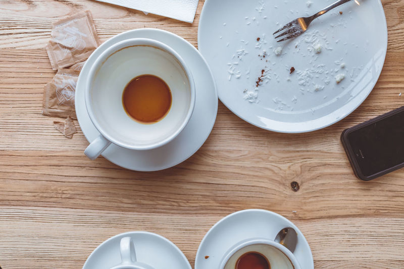 Breakfast Close-up Coffee - Drink Coffee Cup Cup Day Directly Above Drink Food Food And Drink Freshness High Angle View Indoors  Leftovers No People Plate Refreshment Saucer Still Life Table Tea - Hot Drink Wood - Material
