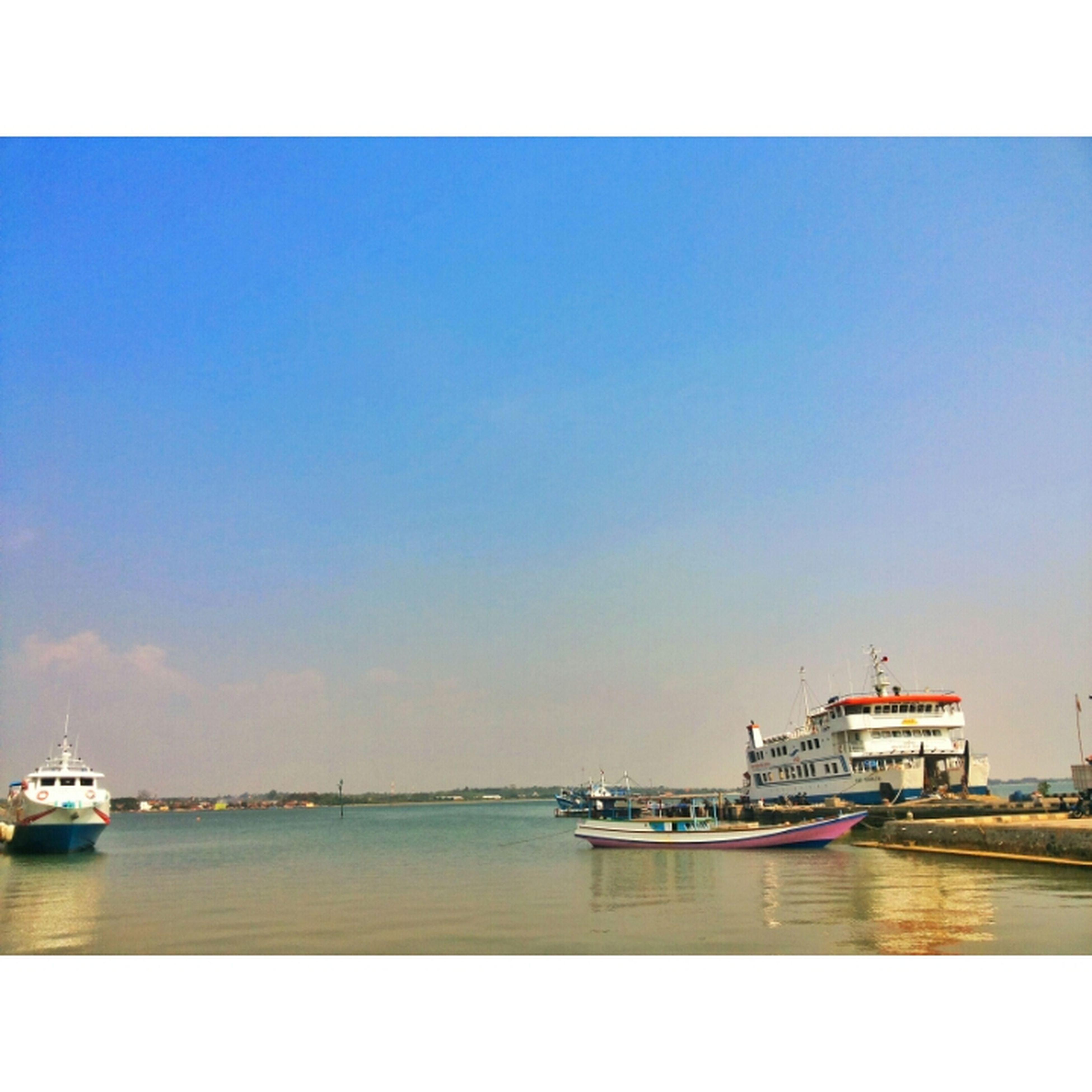 water, nautical vessel, sea, transportation, copy space, boat, clear sky, mode of transport, waterfront, tranquil scene, tranquility, horizon over water, moored, scenics, blue, beauty in nature, transfer print, nature, auto post production filter, sky