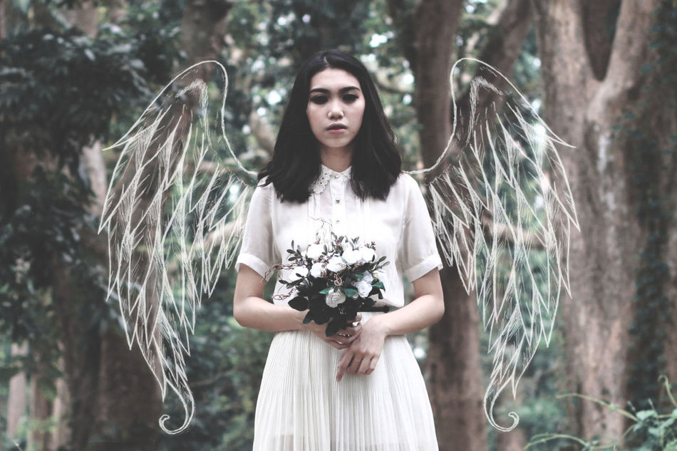 Beautiful stock photos of angel,  20-24 Years,  Animal Wing,  Art,  Asian And Indian Ethnicities