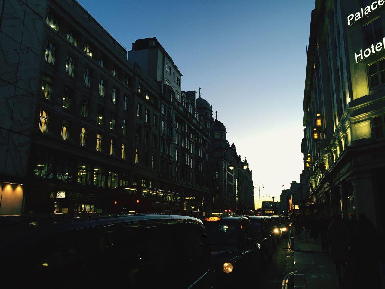 The Strand Taxis Black Cabs Queueing Traffic London Street Evening Sky Evening Light Window Light Blue Wave