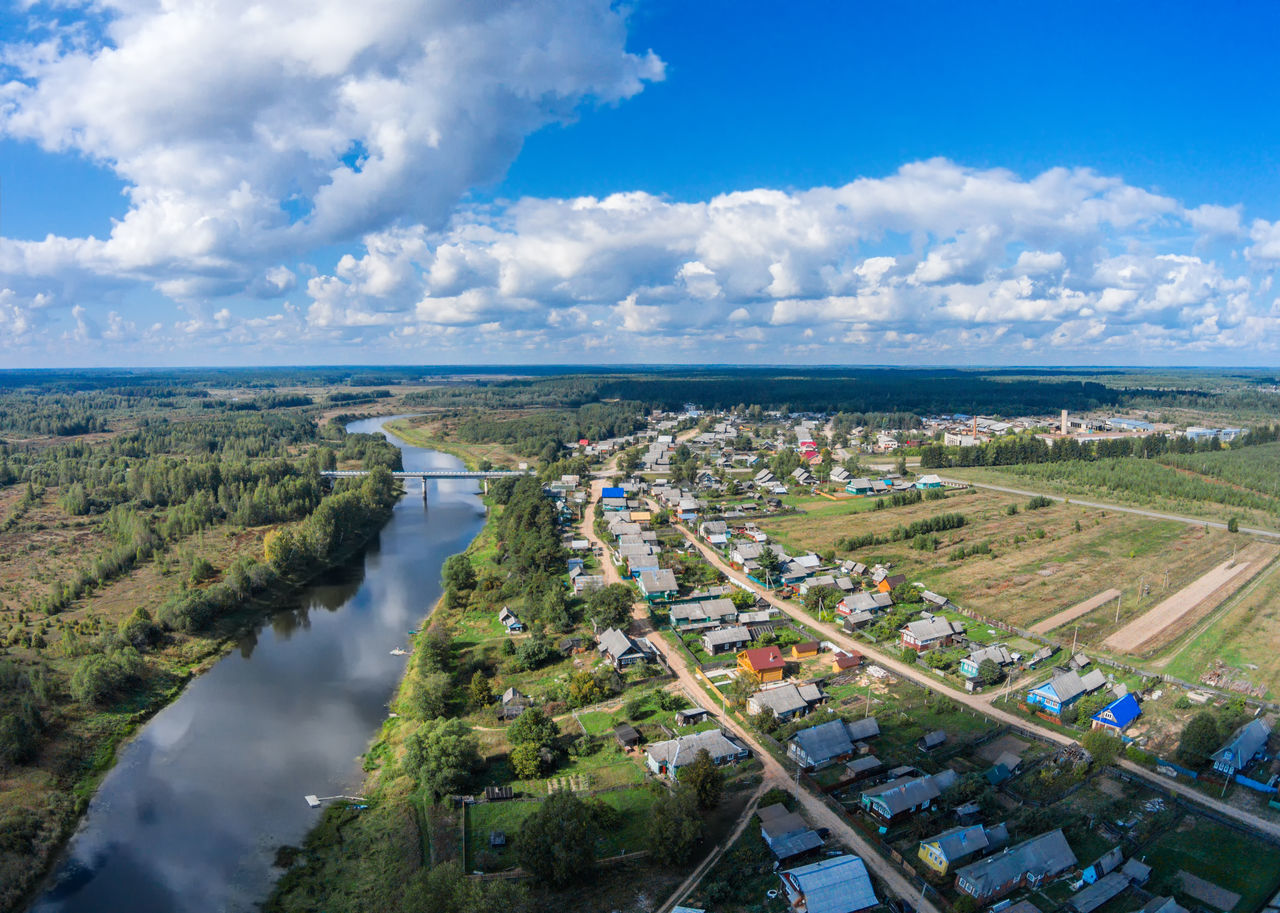 Views of the villages on the river Mologa. A Bird's Eye View Aerial View Beauty In Nature Blue Sky Bridge - Man Made Structure City Cityscape Cloud - Sky Day Dji Dji Phantom Drone  Fabrika High Angle View No People Outdoors Rural Scene Sky Top Perspective Travel Destinations Urban Skyline Water