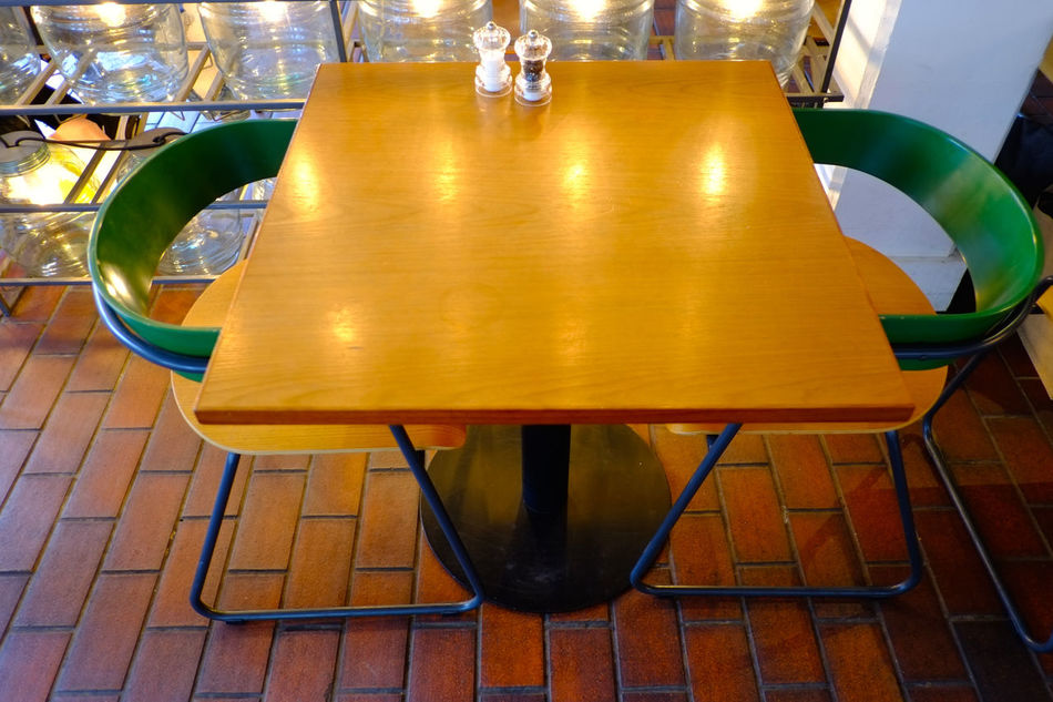 Design elements at modern-style bar/cafe/restaurant Arrangement Chair Close-up Empty Food And Drink Industry Indoors  Interior Design Modern Design Night No People Place Setting Restaurant Seat Table