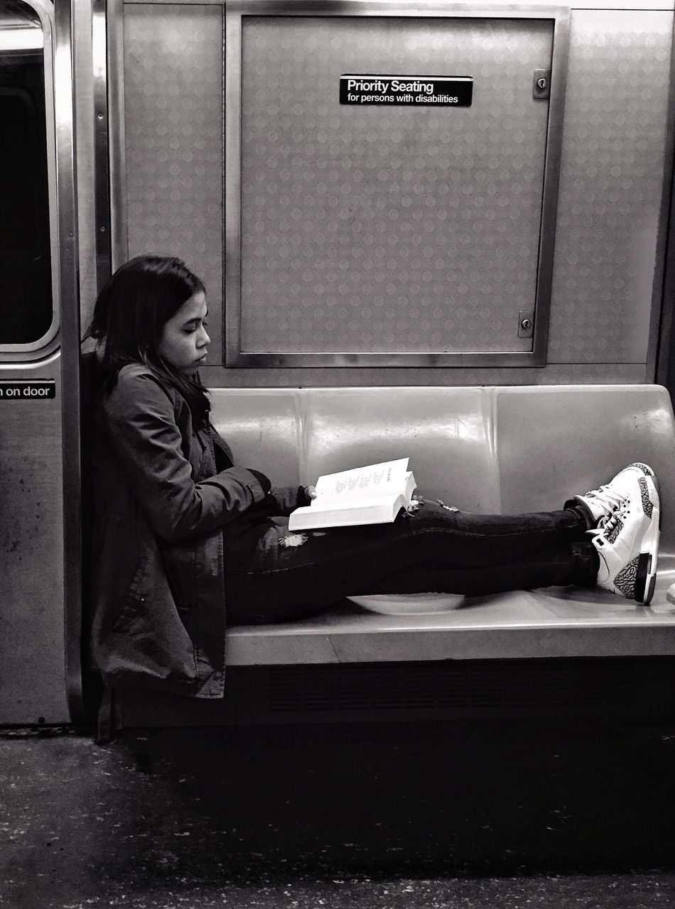 People Of New York Streetphotography Streetportrait Public Transportation Blackandwhite Bnw One Person Train - Vehicle Book Transportation Sitting Indoors  Full Length Lifestyles Real People Subway Train Young Adult People Day Adult Adults Only Mpro Iphone6 Mobilephotography