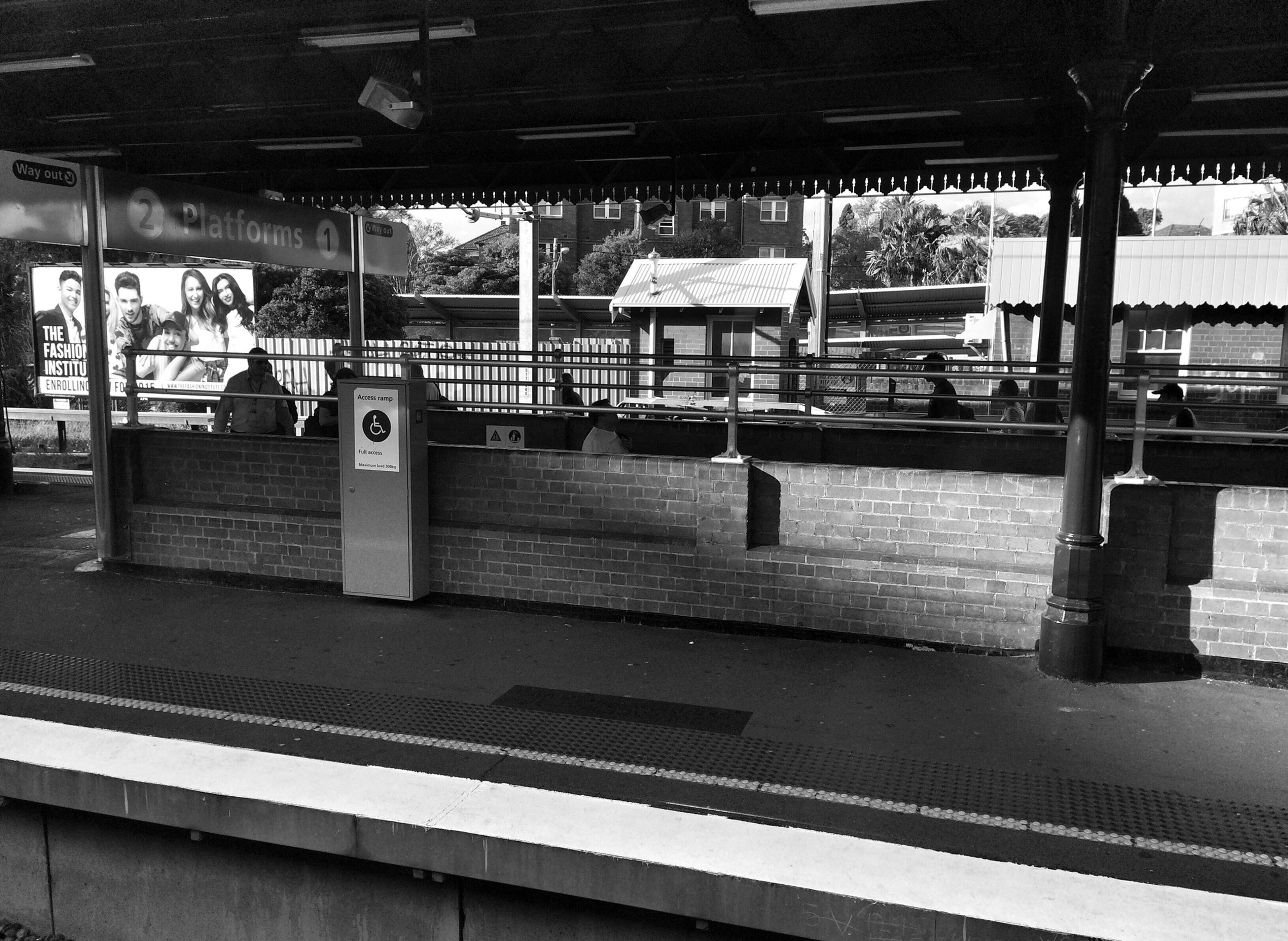 indoors, built structure, architecture, transportation, public transportation, railroad station, railroad station platform, empty, rail transportation, ceiling, architectural column, interior, mode of transport, railing, absence, incidental people, day, window, railroad track, column