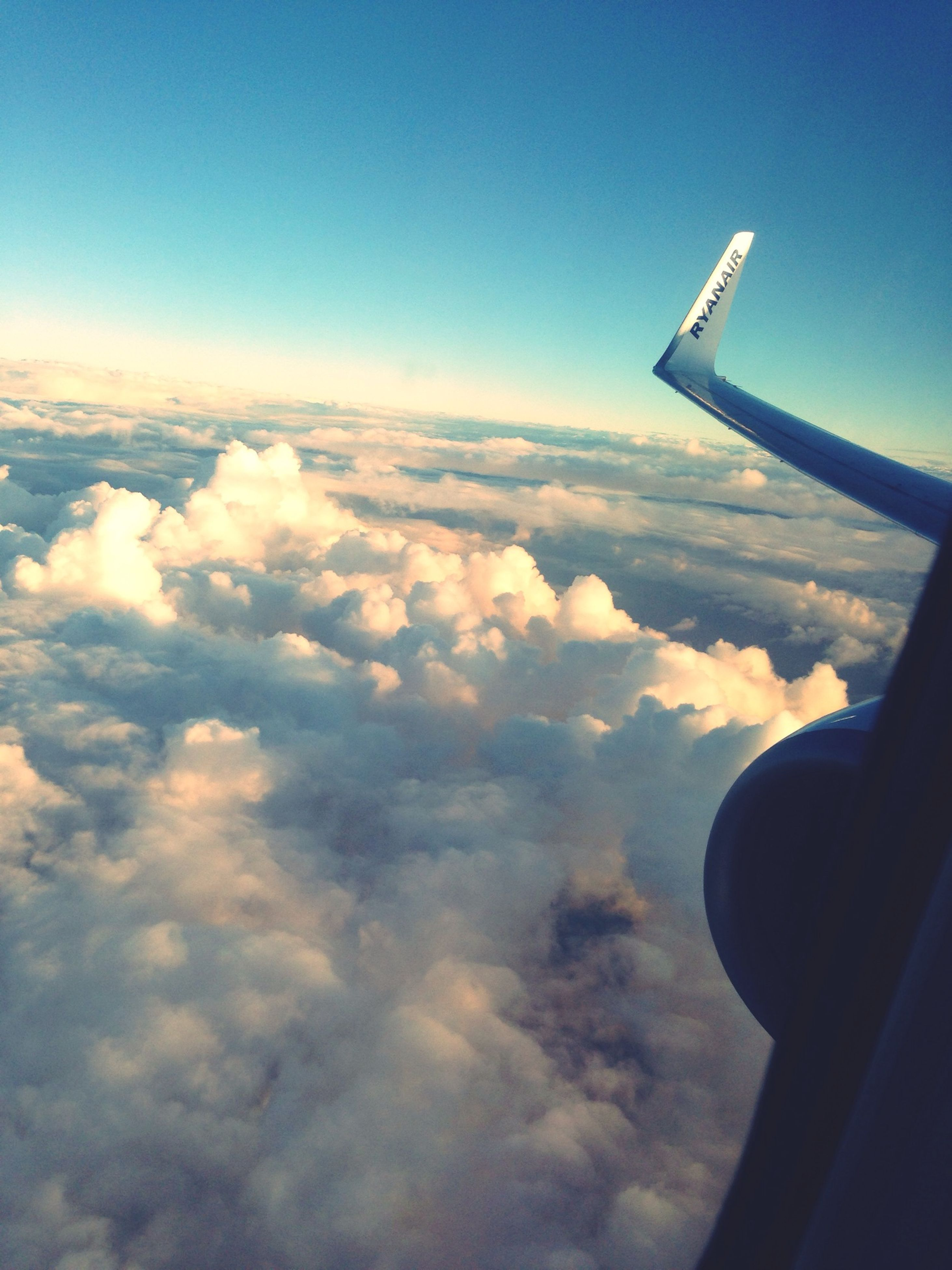 airplane, flying, air vehicle, aircraft wing, sky, transportation, mode of transport, part of, cropped, aerial view, cloud - sky, mid-air, scenics, cloud, journey, travel, cloudscape, blue, beauty in nature, public transportation