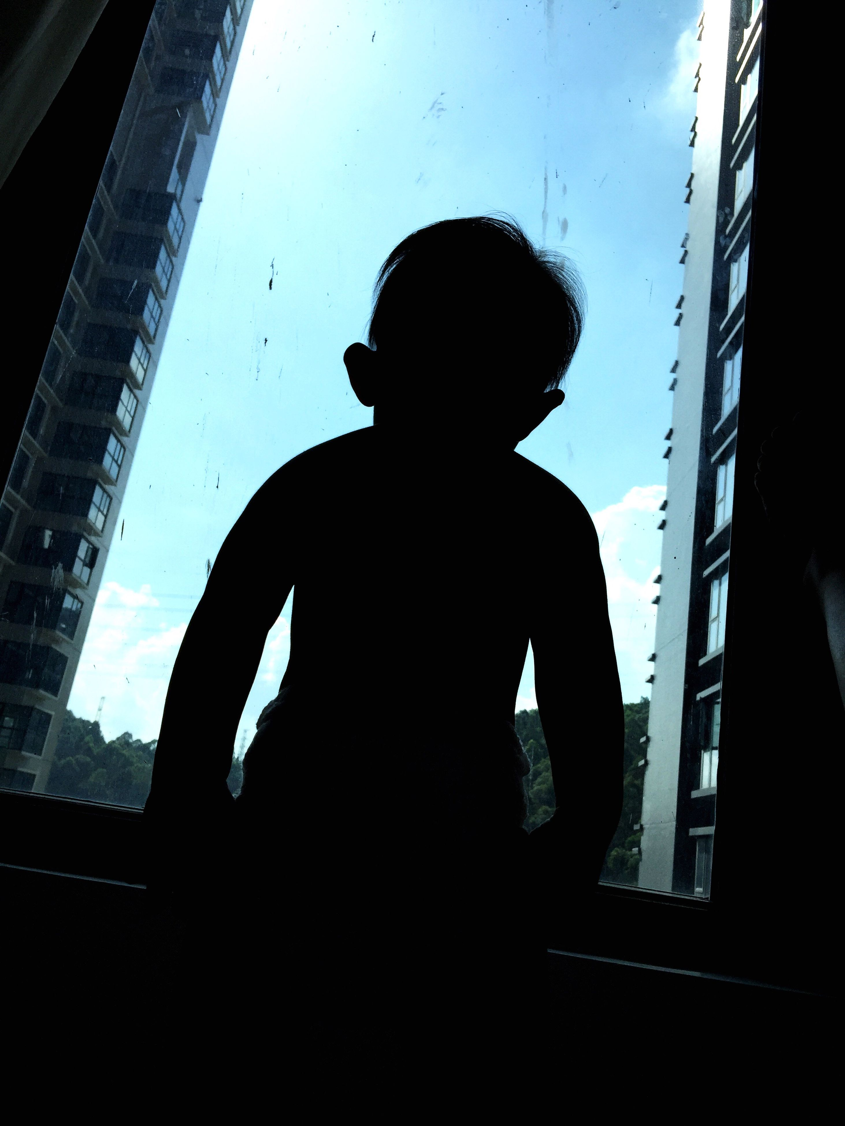 window, silhouette, indoors, looking through window, one person, low angle view, standing, childhood, day, real people, people