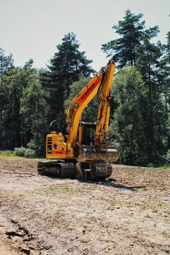 Construction Machinery Construction Site Tree Earth Mover Machinery Construction Vehicle Day Land Vehicle No People Outdoors Sky