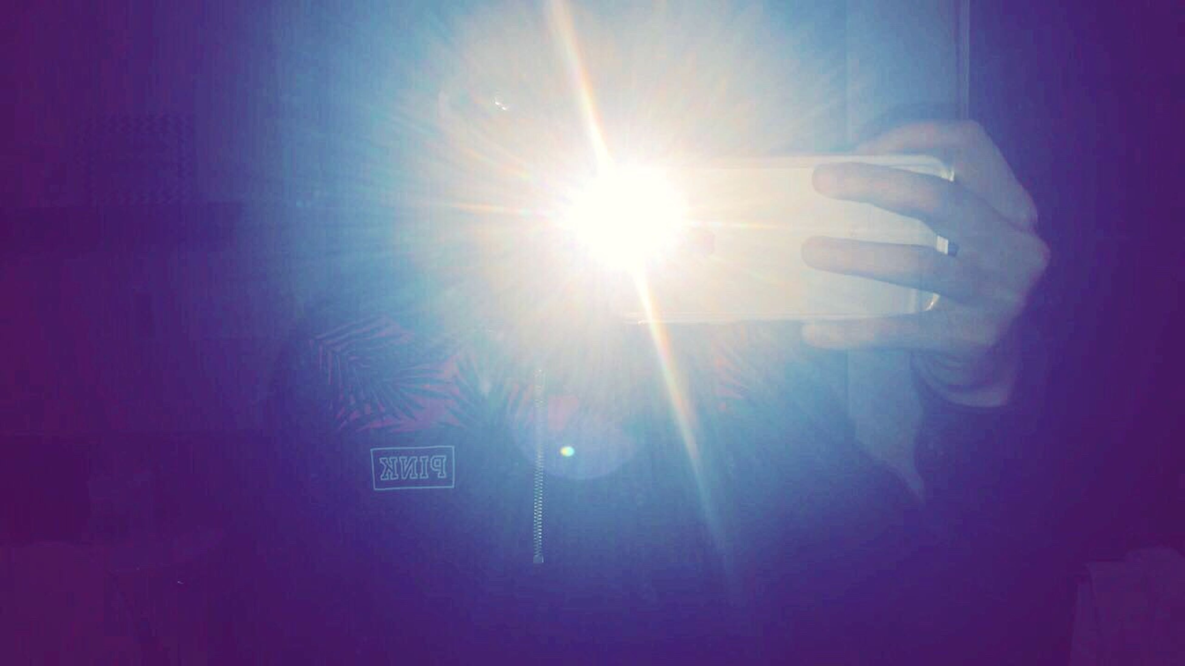 lens flare, communication, human body part, human hand, technology, illuminated, sun, one person, close-up, outdoors, day, people, sky