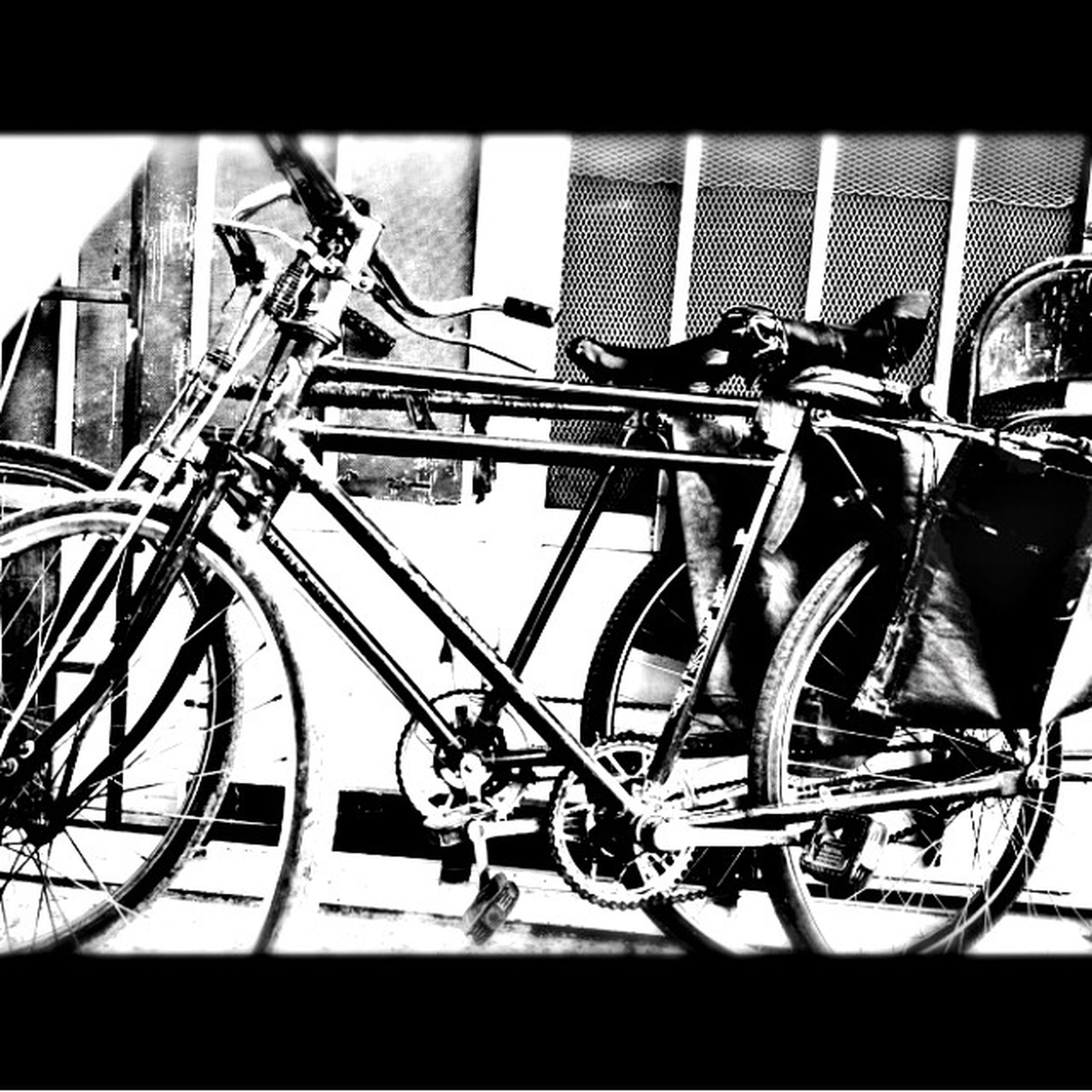 bicycle, land vehicle, mode of transport, building exterior, built structure, architecture, stationary, transportation, transfer print, parked, auto post production filter, parking, railing, window, day, no people, metal, outdoors, wheel, low angle view