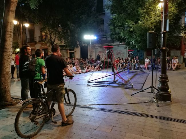 The Street Photographer - 2017 EyeEm Awards Night Bicycle Large Group Of People Street Real People Illuminated Street Light City Life Show Balancing Act